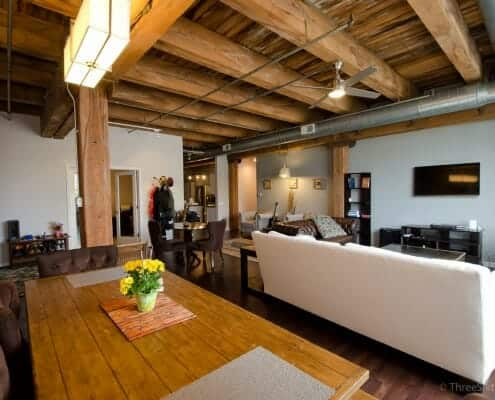 Open living and dining area with massive exposed timber ceilings make this authentic west loop loft uniques space..