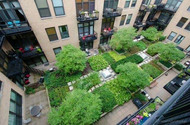Photo looking down into the lush green interior garden courtyard at No. Ten Lofts in the Chicago West Loop neighborhood.