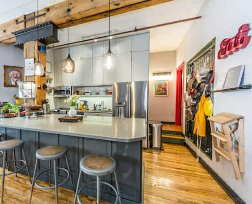 Chicago loft kitchen with timber beam - buy this loft!