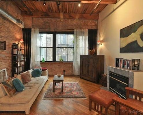 Classic brick and timber Chicago loft living area 495x400