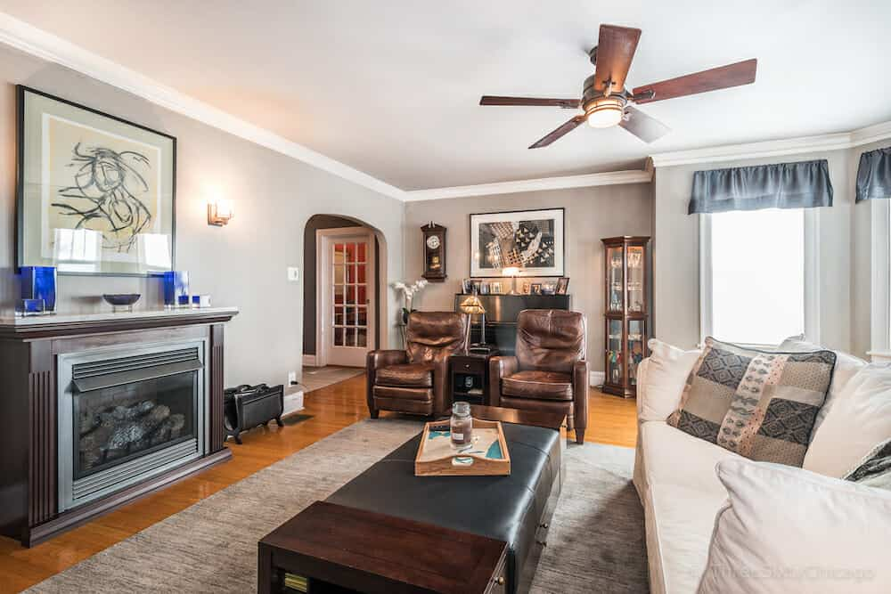 Arched entry to the living room with fireplace in this classic Chicago bungalow.