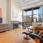 Sunny Printer's Row loft. 547 S. Clark Street Unit 704 - Living, Balcony, Fireplace