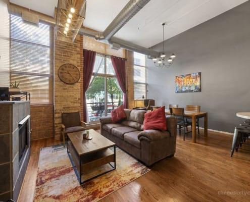 Living Area - 417 S Jefferson, Unit 102B, Chicago IL 60607 - One Bedroom brick & timber loft